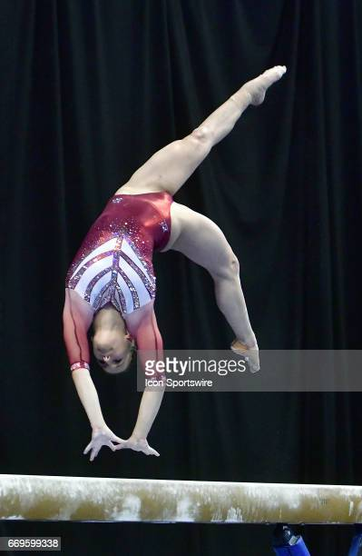 Oklahoma's Stefgani Catour performs a flip on the balance beam during her perfect ten routine during the finals of the NCAA Women's Gymnastics...