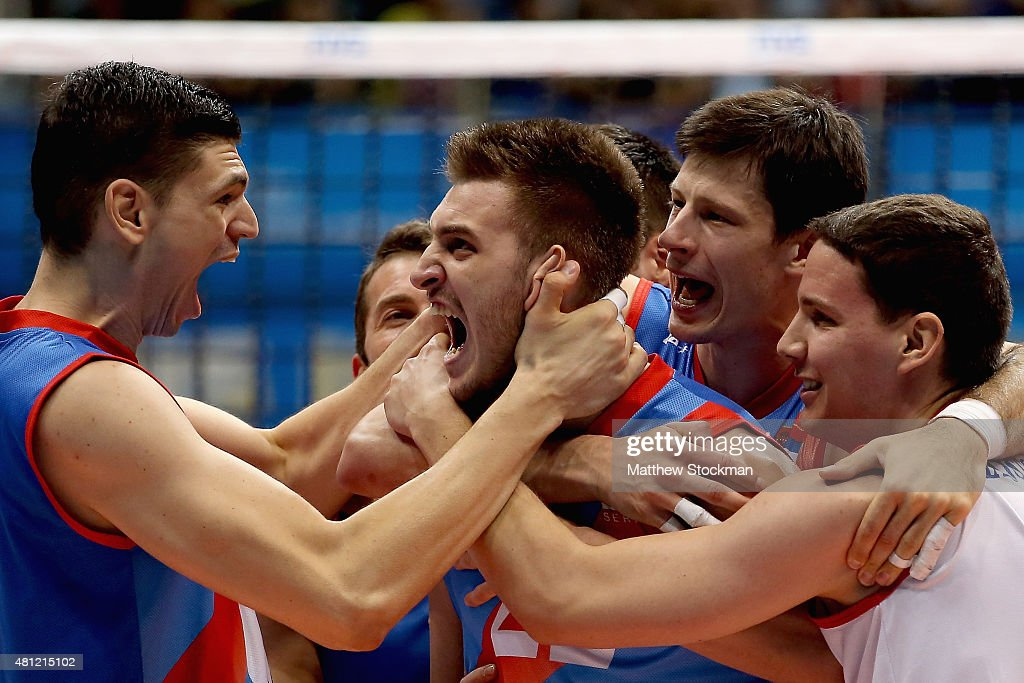 Okolic Aleksandar of Serbia celebrates an ace late into the fifth set with teammates Marko Podrascanin Srecko Lisinac and Neven Majstorovic during...