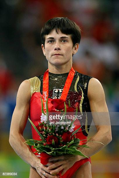 Oksana Aleksandrovna Chusovitina of Germany poses on the medal stand after winning the silver medal in the women's individual vault final during the...