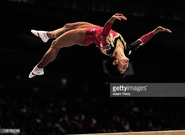 Oksana Chusovitina of Germany competes on the Beam aparatus in the Women's qualification during day two of the Artistic Gymnastics World...