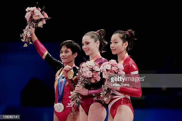 Oksana Chusovitina of Germany Mc Kayla Maroney of the USA and Thi Ha Thanh Phan of Vietnam tands on the podium celebrate after theVault apparatus...