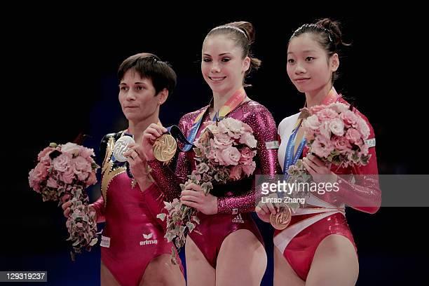 Oksana Chusovitina of Germany Mc Kayla Maroney of the USA and Thi Ha Thanh Phan of Vietnam stand on the podium after the Vault apparatus finals...