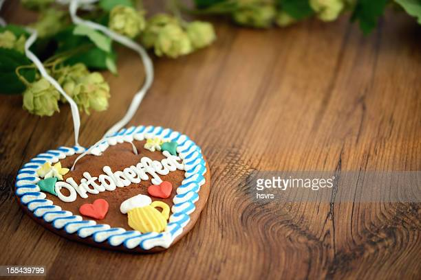 Oktoberfest Gingerbread Cookie on table with hop and copy space