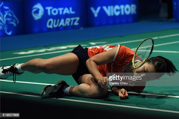 Okuhara Nozomi of Japan falls during her match against Buranaprasertsuk Pomtip of Thailand during day three of the Women Singles during the BWF World...