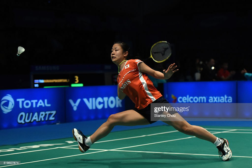 Okuhara Nozomi of Japan returns to Buranaprasertsuk Pomtip of Thailand during day three of the Women Singles during the BWF World Super Series Badminton Malaysia Open at Stadium Malawati on April 7, 2016 in Shah Alam, Malaysia.