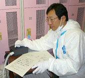Okuma Japan Takeshi Tanigawa of the Ehime University School of Medicine engages in medical examination of workers undertaking stabilization efforts...