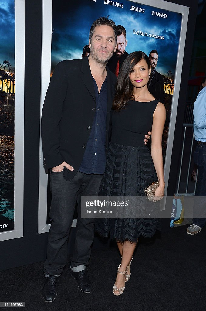 Ol Parker and Thandie Newton attend the premiere of 'Rogue' at ArcLight Cinemas on March 26, 2013 in Hollywood, California.