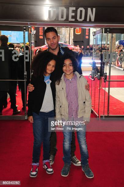Ol Parker with children Ripley Parker and Nico Parker arriving for the premiere of Iron Man 3 at the Odeon Leicester Square London