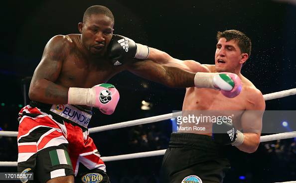 Ola Afolabi of Great Britain exchange punches with Marco Huck of Germany during their WBO Cruiserweight title fight at Max Schmeling Halle on June 8...