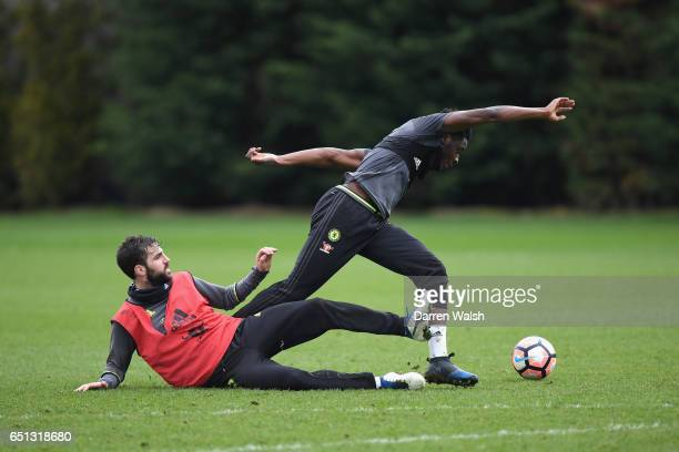 Ola Aina and Cesc Fabregas of Chelsea during a training session at Chelsea Training Ground on March 10 2017 in Cobham England