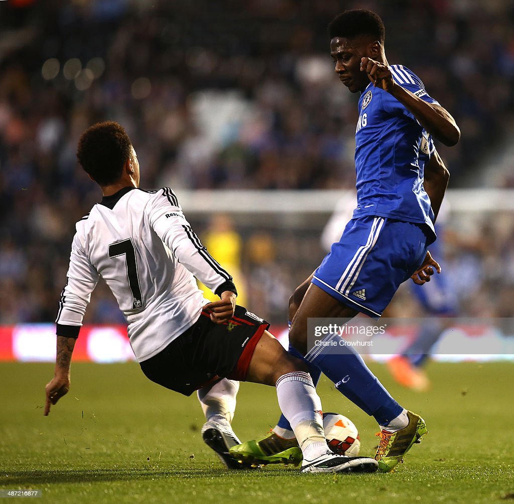 Ola Aina of Chelsea battles for the ball with Fulham's Joshua Smile during the FA Youth Cup Final: First Leg match between Fulham and Chelsea at Craven Cottage on April 28, 2014 in London, England.