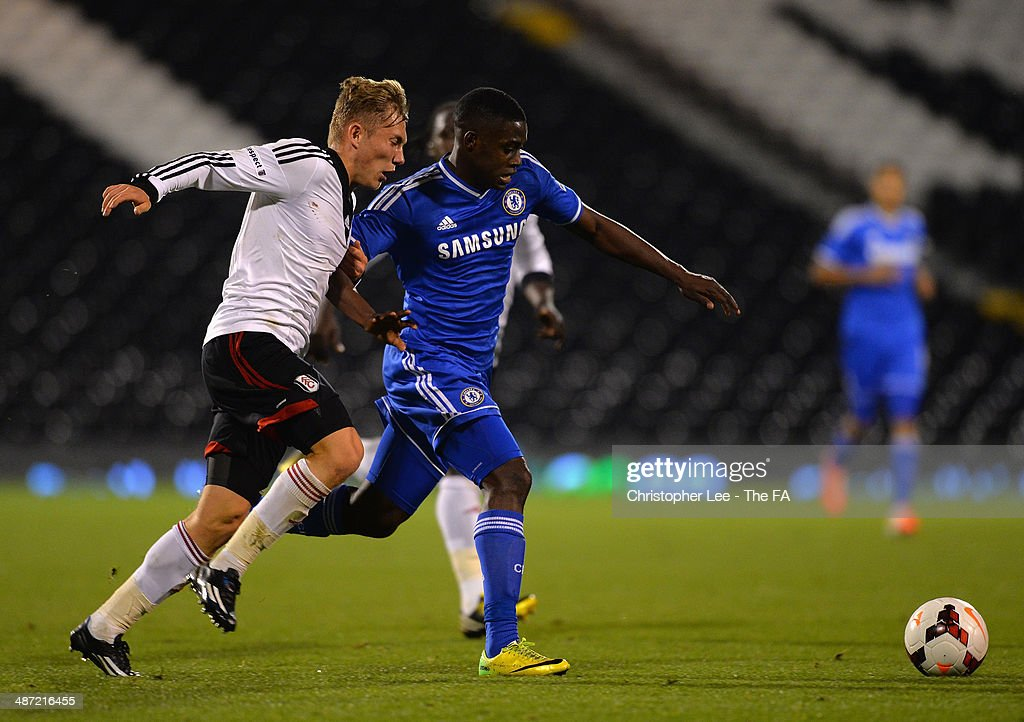 Ola Aina of Chelsea battles with Jordan Evans of Fulham during the FA Youth Cup Final First Leg match between Fulham U18 and Chelsea U18 at Craven Cottage on April 28, 2014 in London, England.