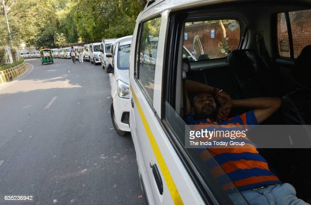 Ola and Uber taxi driver Sleeping in the car during the fourth day of their strike against withdrawal of incentives by the appbased cab aggregators...