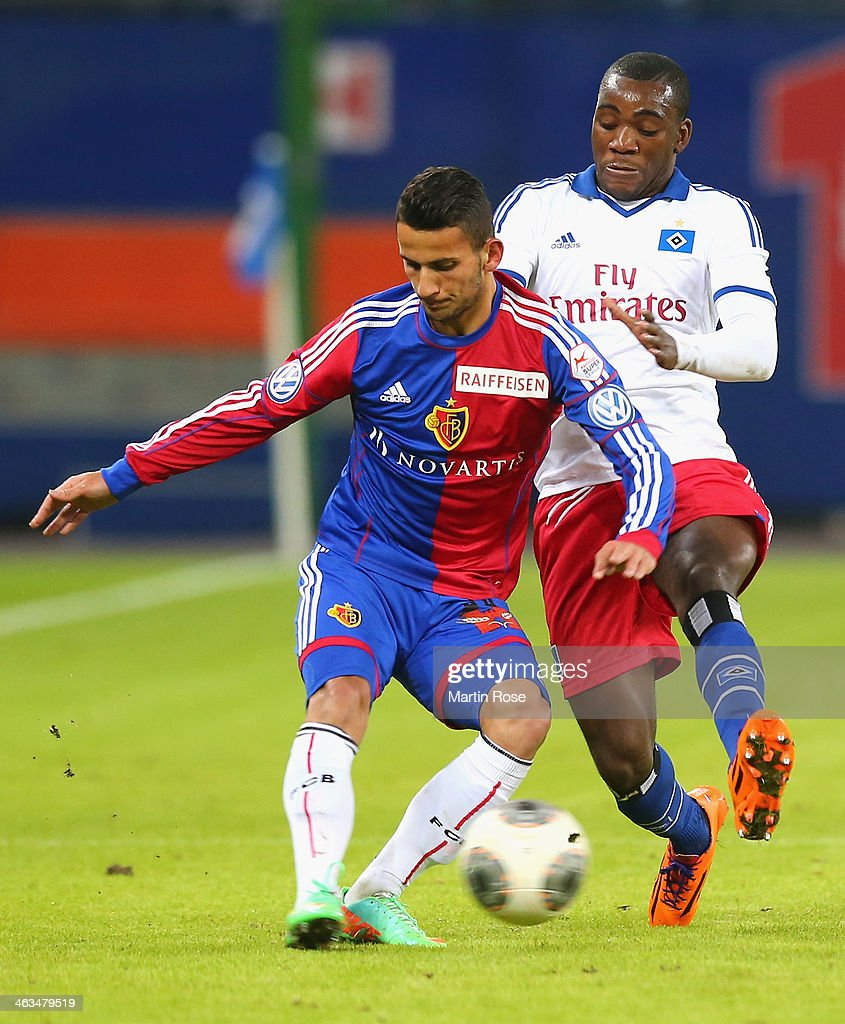 Ola John (R) of Hamburg and Philip Degen (L) of Basel battle for the ball during the friendly match between Hamburger SV and FC Basel at Imtech Arena on January 18, 2014 in Hamburg, Germany.