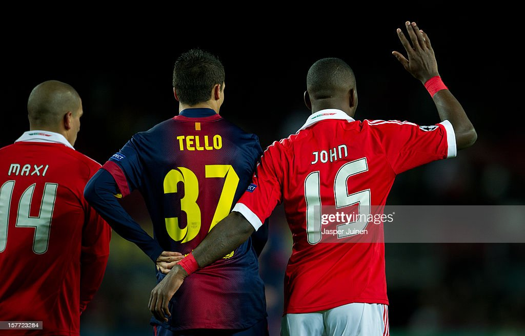 Ola John (R) of SL Benfica gestures during the UEFA Champions League Group G match between FC Barcelona and SL Benfica at the Camp Nou stadium on December 5, 2012 in Barcelona, Spain.