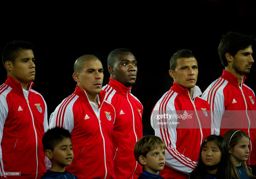 Ola John of SL Benfica stands in between his teammates prior to the start of the UEFA Champions League Group G match between FC Barcelona and SL Benfica at the Camp Nou stadium on December 5, 2012 in Barcelona, Spain.