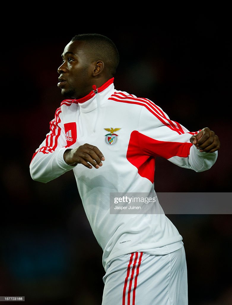 Ola John of SL Benfica warms up for the UEFA Champions League Group G match between FC Barcelona and SL Benfica at the Camp Nou stadium on December 5, 2012 in Barcelona, Spain.