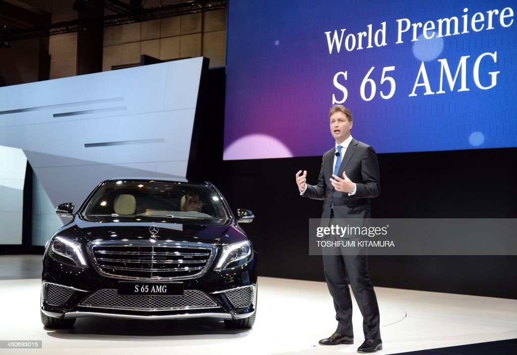 Ola Kallenius, a member of the divisional board, Mercedes-Benz cars, introduces the company's 'S65 AMG' during its premier at the press briefing in the Tokyo Motor Show in Tokyo on November 20, 2013. The motor show, held from November 20 to December 1, features domestic makers of passenger cars, commercial vehicles and trucks alongside most of their European competitors.
