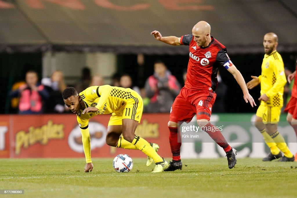 Ola Kamara #11 of the Columbus Crew SC loses his balance while battling for control of the ball with Michael Bradley #4 of the Toronto FC during the second half at MAPFRE Stadium on November 21, 2017 in Columbus, Ohio. Columbus tied Toronto 0-0.