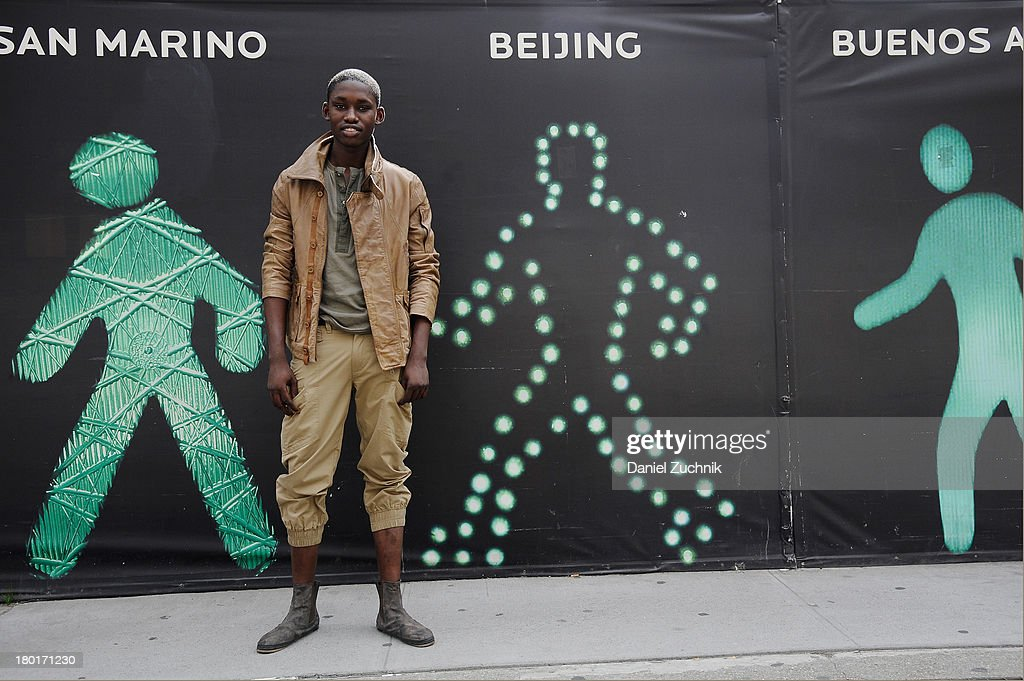 LOOK #14. Ola Morafa, model from Nigeria, wears Nicholas K Spring 2014 Declan jacket in earth (MO-146), Decker t-shirt in earth (MK-107), Ethan pant in earth (MP-091A) and V2 shoes in brown camo (VEESHOO) on the streets of lower Manhattan on September 9, 2013 in New York City.