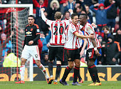 Ola Toivonen Jack Rodwell and Lamine Kone of Sunderland celebrate their win while Chris Smalling of Manchester United leaves the pitch after the...