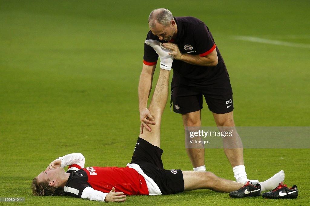 Ola Toivonen of PSV (L), Physiotherapist Cees van der Linden of PSV (R) during the training camp of PSV Eindhoven on January 10, 2013 at Muanghtongh, Thailand.