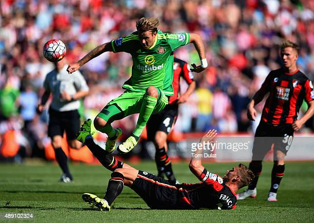Ola Toivonen of Sunderland is tackled by Simon Francis of Bournemouth during the Barclays Premier League match between AFC Bournemouth and Sunderland...