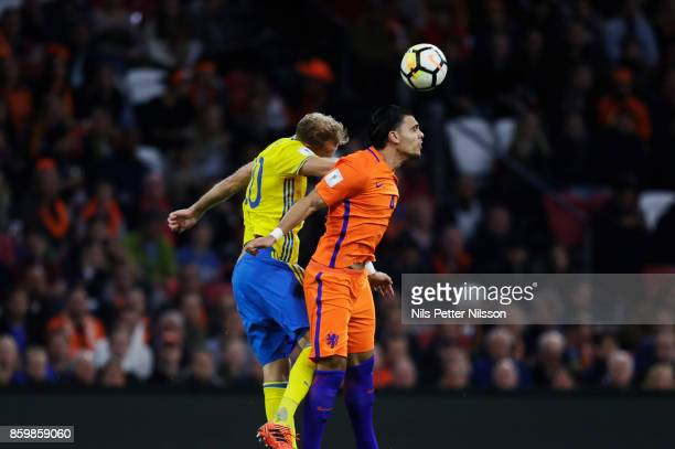 Ola Toivonen of Sweden and Karim Rekik of Netherlands competes for the ball during the FIFA 2018 World Cup Qualifier between Netherlands and Sweden...