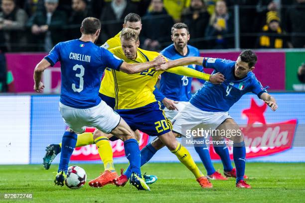 Ola Toivonen of Sweden battles with Giorgio Chiellini and Matteo Darmian of Italy during the FIFA 2018 World Cup Qualifier PlayOff First Leg between...