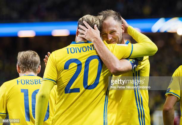 Ola Toivonen of Sweden celebrates after scoring to 80 together with of Sweden Andreas Granqvist during the FIFA 2018 World Cup Qualifier between...