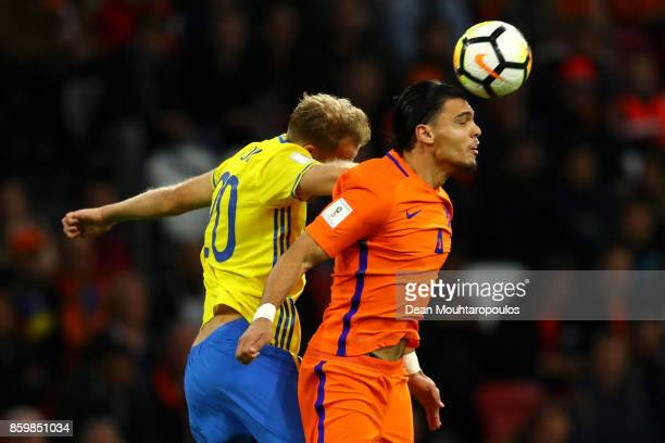 Ola Toivonen of Sweden challenges Karim Rekik of Netherlands during the FIFA 2018 World Cup Qualifier between Netherlands and Sweden at the Amsterdam...