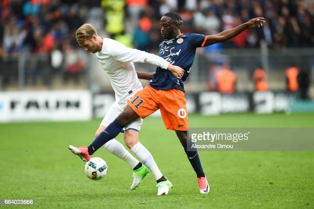 Ola Toivonen of Toulouse and Jonathan Ikone of Montpellier during the French Ligue 1 match between Montpellier and Toulouse at Stade de la Mosson on...