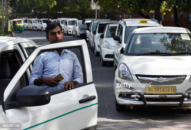 Ola Uber drivers sitting on dharna at Jantar Mantar on February 14 2017 in New Delhi India For the last five days cab aggregators Ola and Uber have...