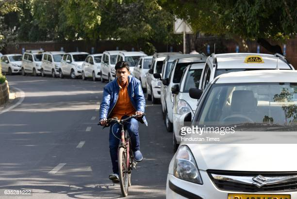 Ola Uber taxis seen at Jantar Mantar on February 14 2017 in New Delhi India For the last five days cab aggregators Ola and Uber have been at...