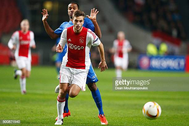 Ola Williams Kamara of Molde FK battles for the ball with Joel Veltman of Ajax during the group A UEFA Europa League match between AFC Ajax and Molde...