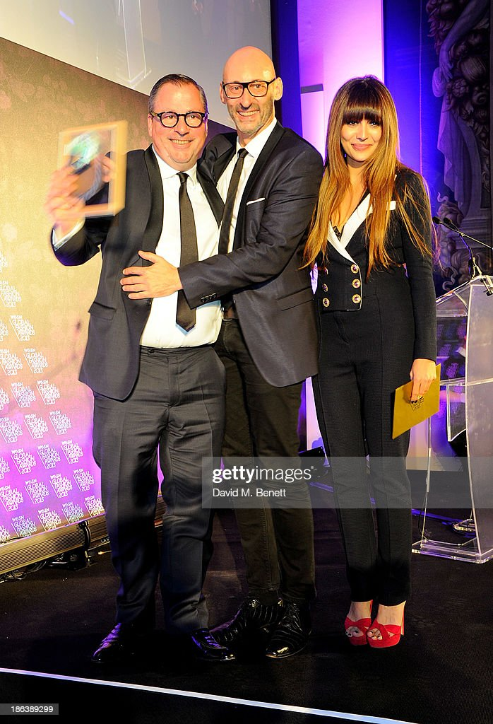 Olaf Becker and Werner Franz from Karl Lagerfeld in Paris, France, winners of the Best New Store / Refit award, and Zara Martin pose onstage at The WGSN Global Fashion Awards at the Victoria & Albert Museum on October 30, 2013 in London, England.