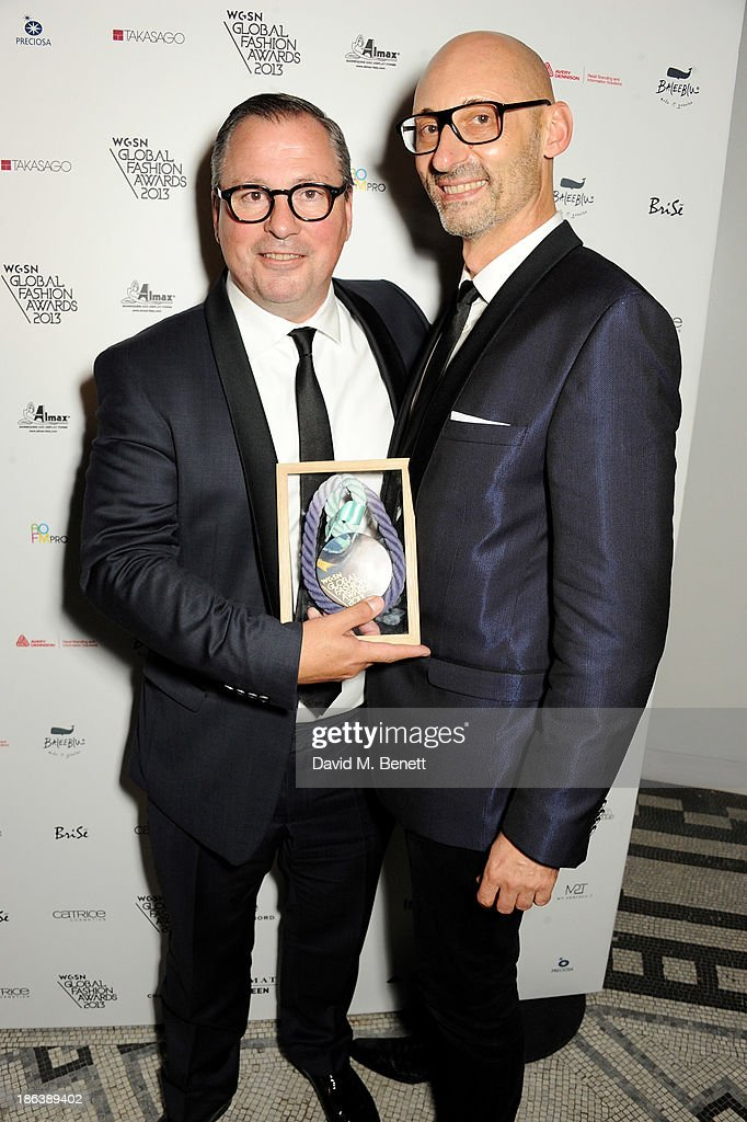 Olaf Becker (L) and Werner Franz from Karl Lagerfeld in Paris, France, winners of the Best New Store / Refit award, pose backstage at The WGSN Global Fashion Awards at the Victoria & Albert Museum on October 30, 2013 in London, England.
