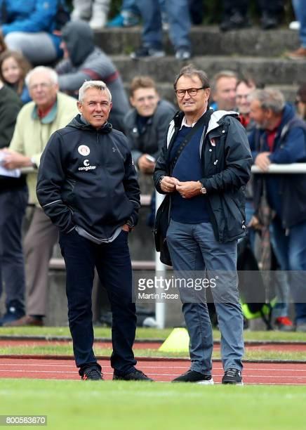 Olaf Janssen head coach of St Pauli talks to technical director Ewald Lienenduring the preseason friendly match between Buxtehuder SV and FC St Pauli...