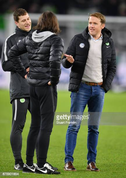 Olaf Rebbe sports director of Wolfsburg talks with Martin Schmidt head coach of Wolfsburg after the Bundesliga match between VfL Wolfsburg and...