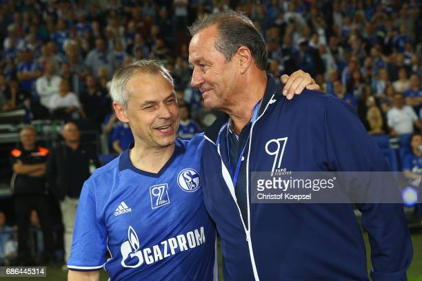 Olaf Thon and head coach Huub Stevens of Eurofighter and Friends talk during the 20 years of Eurofighter match between Eurofighter and Friends and...