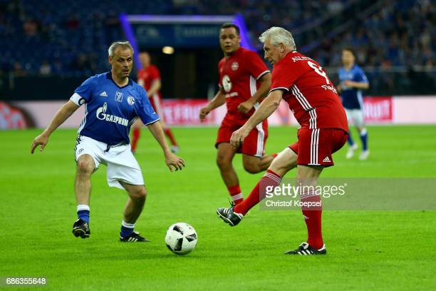 Olaf Thon of Eurofighter and Friends challenges Klaus Fischer of Euro All Stars during the 20 years of Eurofighter match between Eurofighter and...