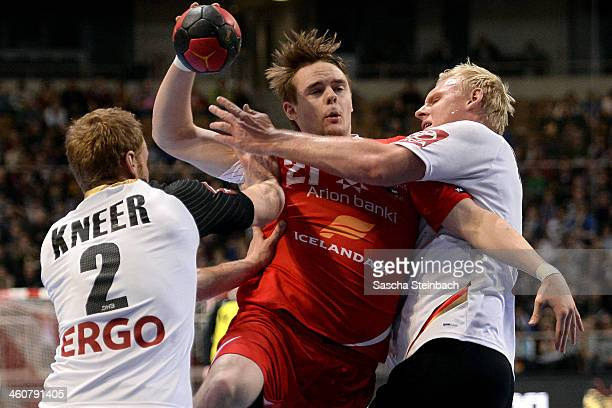 Olafur Bjarki Ragnarsson of Iceland battles for the ball with Stefan Kneer and Patrick Wiencek of Germany during the DHB Four Nations Tournament...