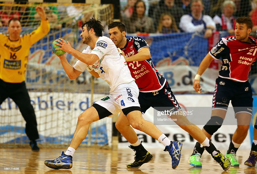 Olafur Gustafsson of Flensburg (R) is challenged by <a gi-track='captionPersonalityLinkClicked' href=/galleries/search?phrase=Domagoj+Duvnjak&family=editorial&specificpeople=2289188 ng-click='$event.stopPropagation()'>Domagoj Duvnjak</a> (L) of Hamburg during the DKB Handball Bundesliga match between SG Flensburg-Handewitt and HSV Hamburg at Flens Arena on April 9, 2013 in Flensburg, Germany.