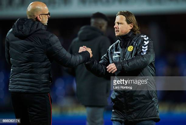 Olafur Kristjansson head coach of Randers FC shake hands with Bo Henriksen head coach of AC Horsens after the Danish Alka Superliga match between...