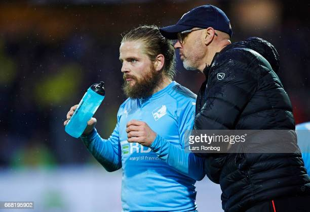 Olafur Kristjansson head coach of Randers FC speaks to Kasper Fisker of Randers FC during the Danish Cup DBU Pokalen quarterfinal match between...