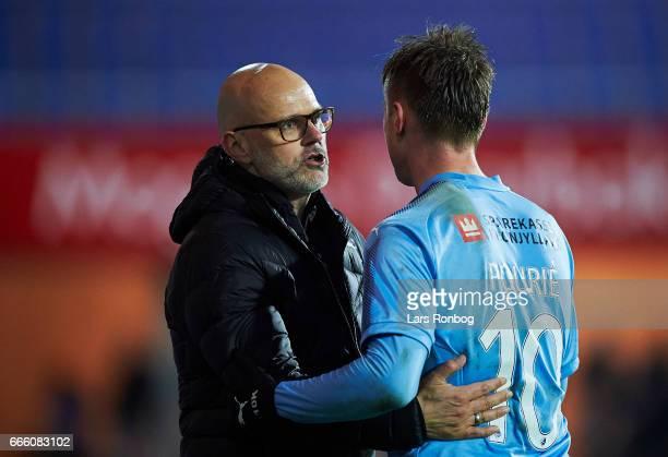 Olafur Kristjansson head coach of Randers FC speaks to Marvin Pourie of Randers FC during the Danish Alka Superliga match between Randers FC and AC...