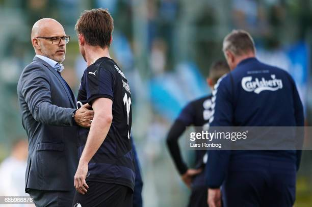 Olafur Kristjansson head coach of Randers FC speaks to Marvin Pourie of Randers FC after the Danish Alka Superliga match between OB Odense and...