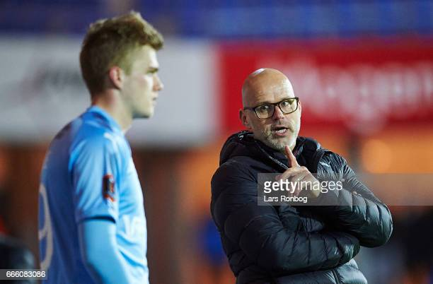Olafur Kristjansson head coach of Randers FC speaks to Mikkel Kallesoe of Randers FC during the Danish Alka Superliga match between Randers FC and AC...