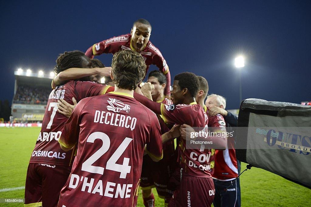 Olafur Skulason of ZulteWaregem celebrates withteammates during the Jupiler League match between Zulte Waregem and Standard de Liege on October 06...