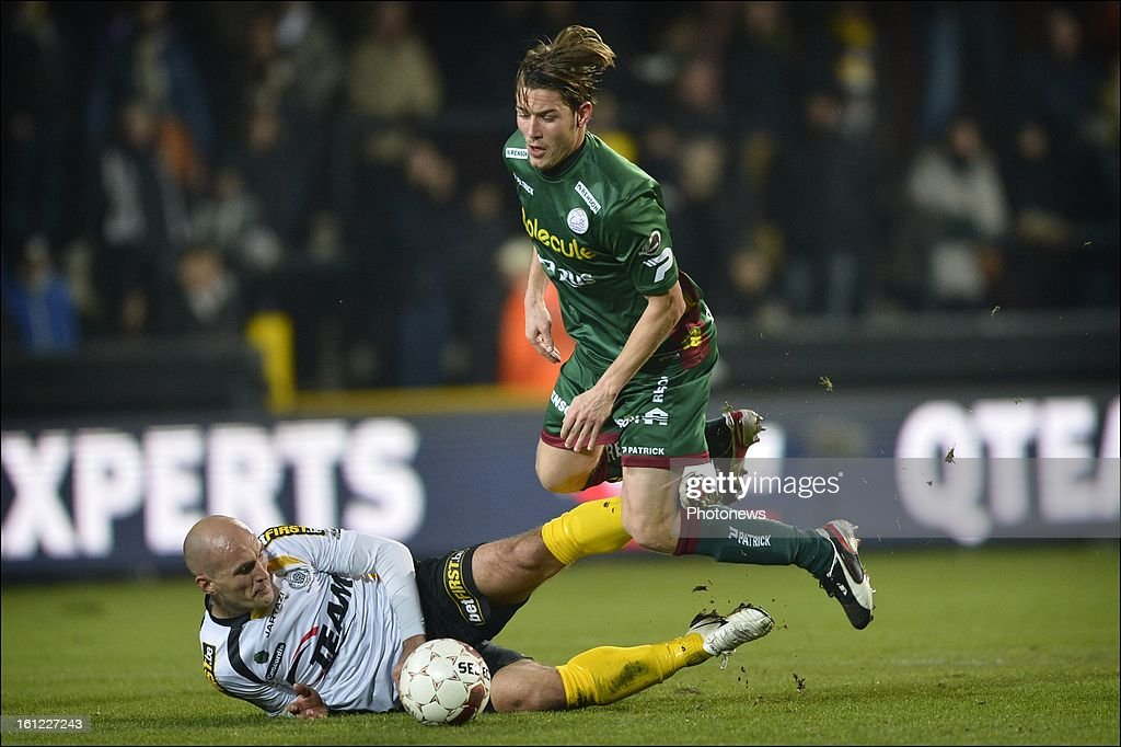 Olafur Skulason of Zulte-Waregem is fouled by Milos Maric of Sporting Lokeren OVL during the Jupiler League match between Sporting Lokeren Oost-Vlaanderen and SV Zulte Waregem at the Daknam Stadium on February 9, 2013 in Lokeren, Belgium